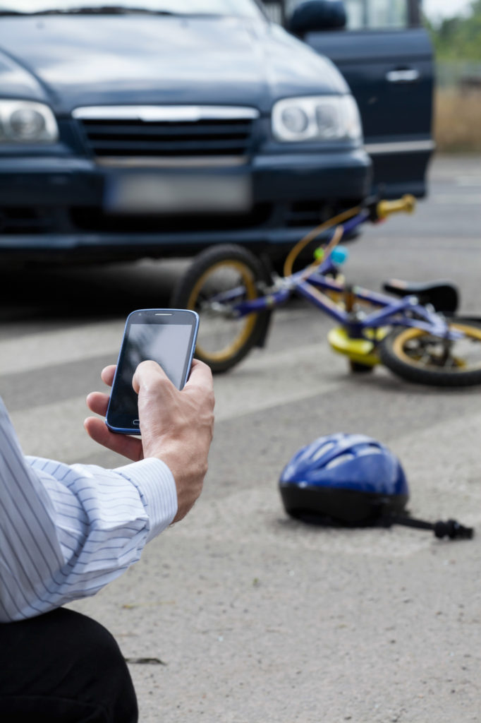 A witness calling for help after crashing into a kid on a bike