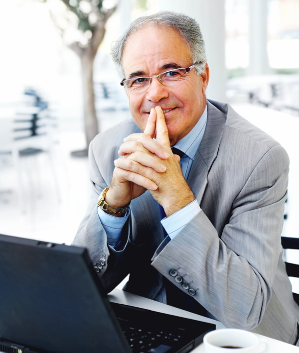 Middle-aged business man in suit with a laptop